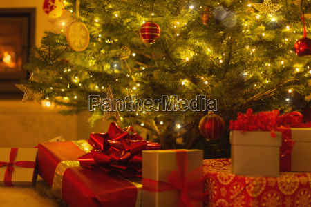 gifts with red bows under illuminated