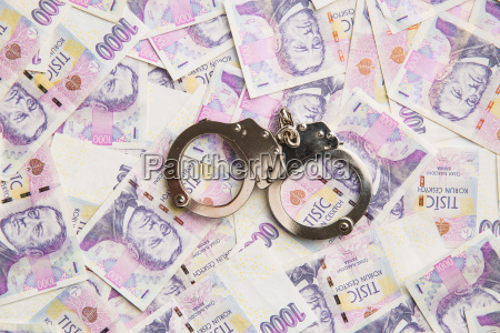 handcuff and money