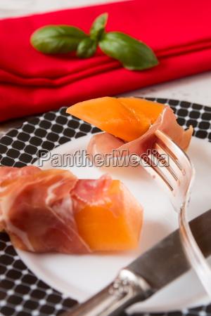 close up of prosciutto and melon