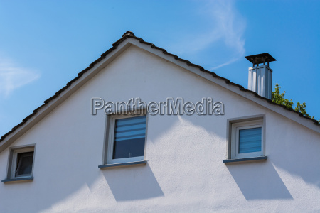 house facade in front of blue
