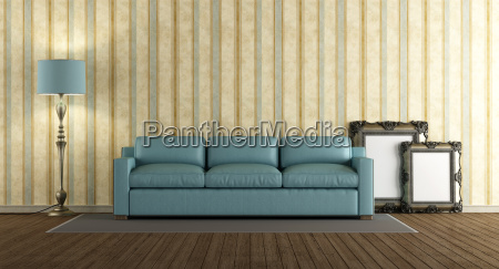 blue leather sofa in a classic