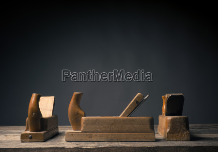 old wood plane on rustic plank