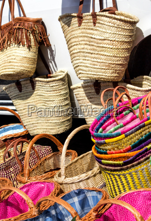 colorful shopping baskets and shopping bags