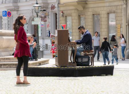 woman listening to a street musician