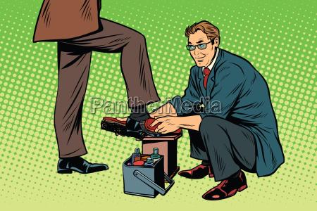 businessman shoe shiner
