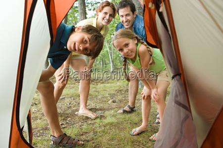 family looking into tent