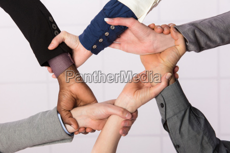 united hands of business team