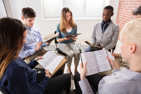 group of people reading bibles
