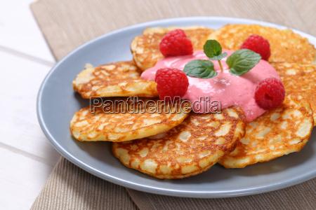 american pancakes with yogurt and raspberries