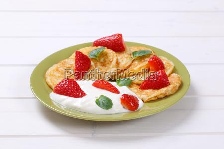 american pancakes with yogurt and strawberries