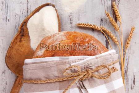 bread with flour on wooden table