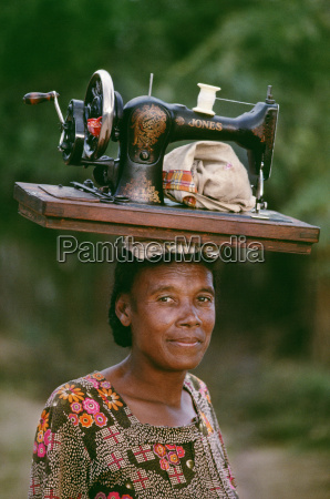 mahafaly woman carrying sewing machine southern