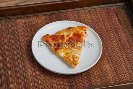 pizza slice on a plate