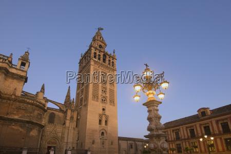 spain seville giralda tower at dusk