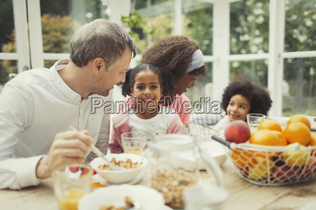 portrait smiling multi ethnic young family