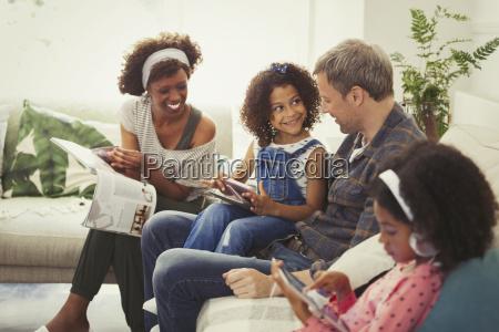 multi ethnic young family using digital