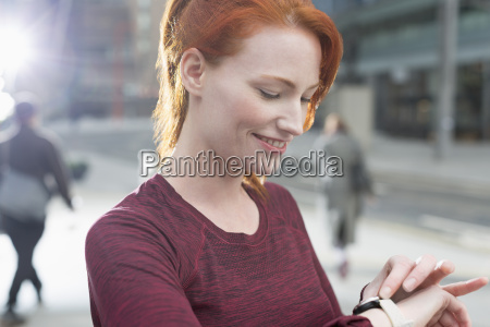 close up smiling female runner checking