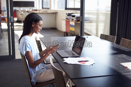young black woman in office using
