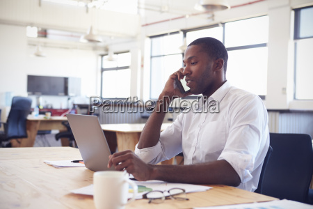 young black man working in office