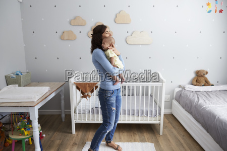 mother, comforting, newborn, baby, son, in - 22046595