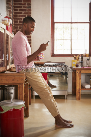young black man using smartphone in