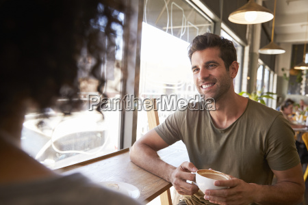 couple meeting for date in coffee