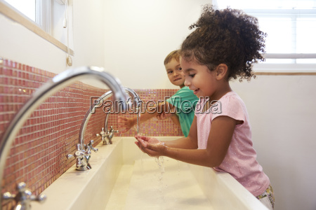 pupils at montessori school washing hands