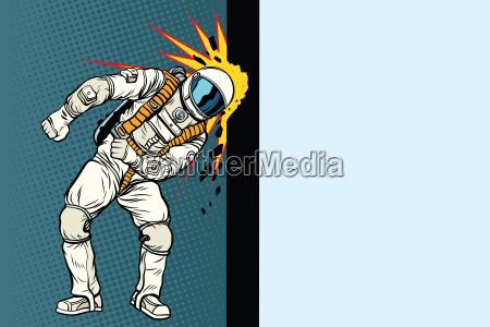 cosmonaut knocks head on the wall