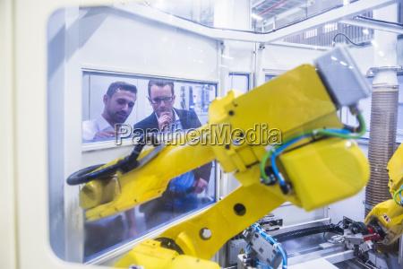 two men in factory shop floor