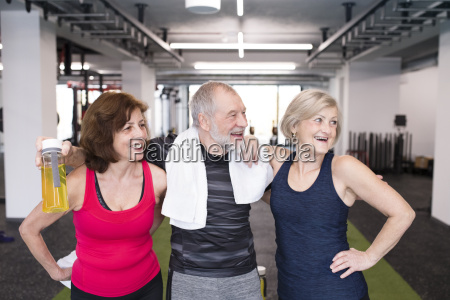 group of fit seniors in gym