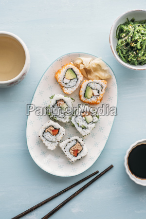sushi rolls on a plate wakame