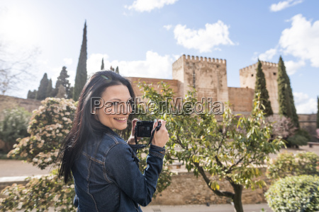 spain granada smiling young woman taking