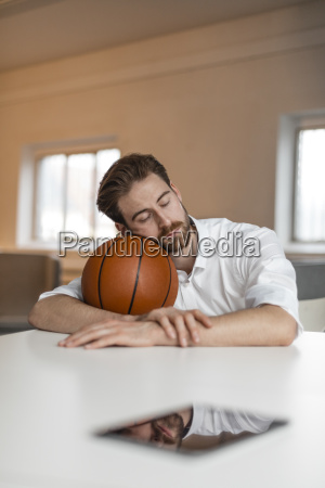 portrait of young freelancer with basketball