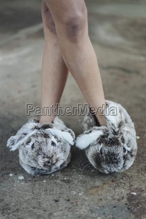 woman wearing cute fluffy slippers
