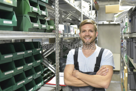 portrait of smiling man in warehouse