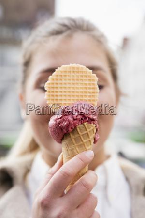 womans hand holding ice cream cone