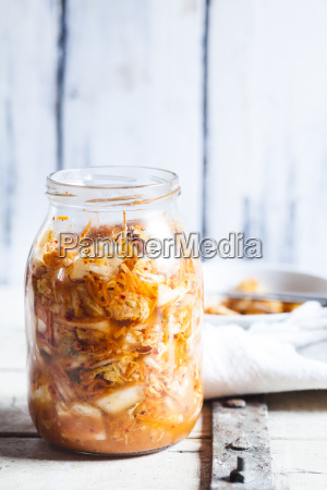 glass of homemade korean kimchi with