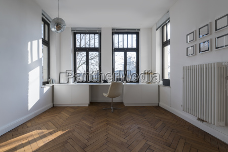 empty room with chair and large
