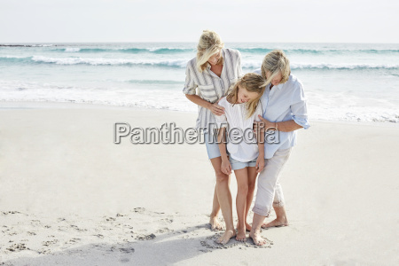 mother daughter and grandmother standing in