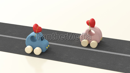 two wooden toy cars with hearts