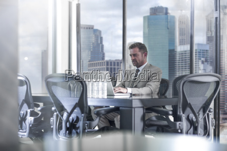 businessman with laptop in city office