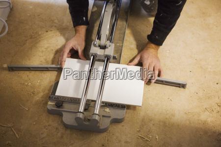 a builder tiler kneeling on the