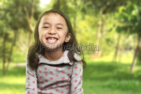 funny asian little girl smile with