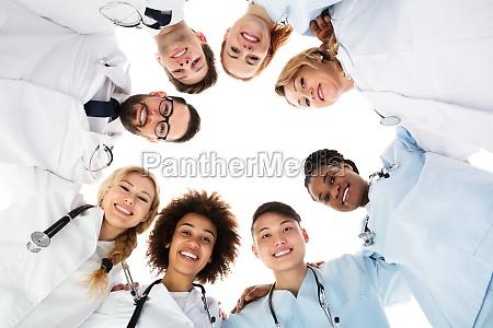 happy medical team forming huddle