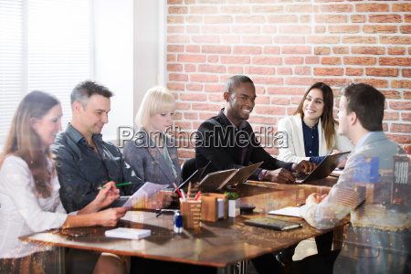 diverse businesspeople discussing in the meeting