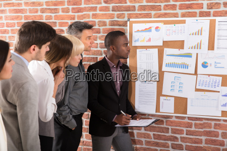 business colleague looking at graph
