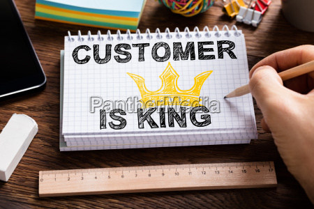 person drawing customer is king chart