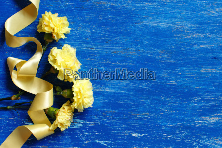 light yellow carnations with yellow silk