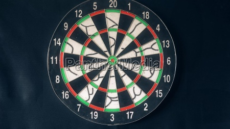 six dart arrows hitting in dartboard