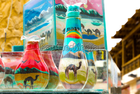 decorative glass bottles with colored sand